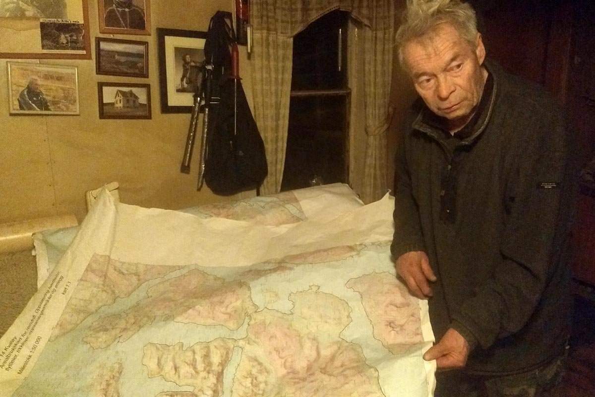 Inside his little house, Per Kitti shows a map