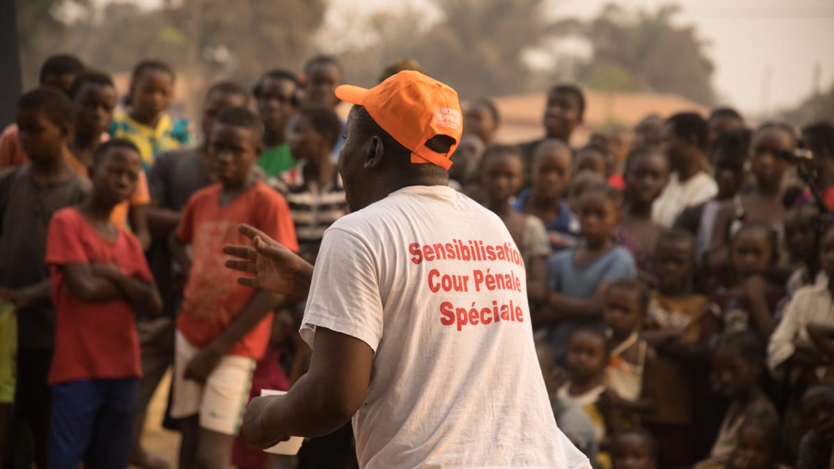 An actor/facilitator on a mission to raise awareness about SCC in the streets of Bangui.