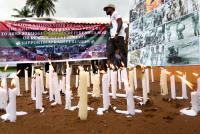 Banners and candles are displayed during a ceremony commemorating the Biafran War. © Sia Kambou / AFP