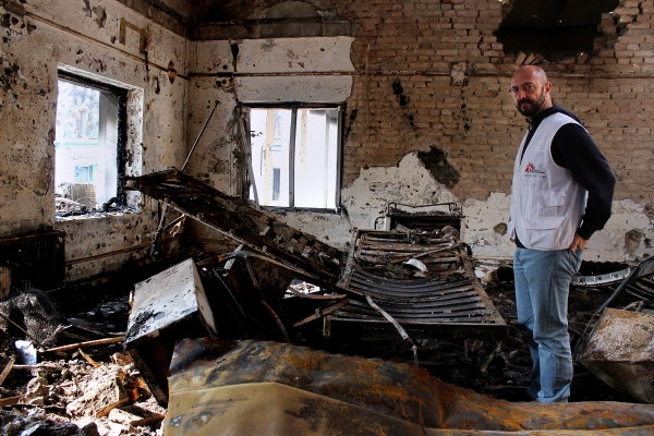 In this photograph taken on November 10 ,2015, a member of Medecins Sans Frontieres (MSF) staff looks on in a charred ward of the damaged Medecins Sans Frontieres (MSF) hospital in northern Kunduz. On October 3, 2015 US forces bombed the MSF Hospital in northern Kunduz, killing at least 30 people, sparking an avalanche of global condemnation and forcing the French-founded charity to close the trauma centre.