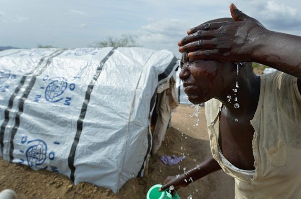 A woman washes her face on March 12, 2014 in a camp for almost 500 internally displaced people located at the St. Vincent de Paul Catholic parish on the edge of Juba. The families here fled fighting that broke out in December 2013.