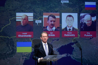 Chief prosecutor of The Netherlands Fred Westerbeke, at a press conference of the Joint Investigation Team, on June 2019, next to the pictures of the four men accused in the MH17 trial that just opened. © John Thys / AFP