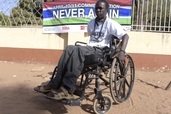 Yusuf Mbye, 35, demonstrates with other victims of the Jammeh regime. He was injured in a protest in 2000 and has been paralysed ever since.
