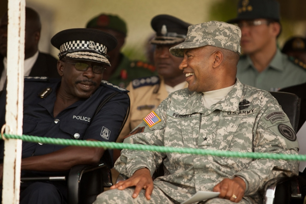 Brigadier General Robert Ferrell shares a laugh with Ousman Sonko, the Inspector General of the Gambian Police, during the opening ceremony for Operation African Endeavor 2011 in Banjul