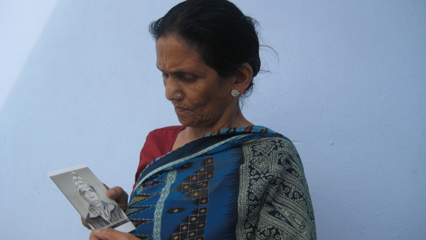 Woman in Katmandu with a photograph of her husband disappeared in 2001