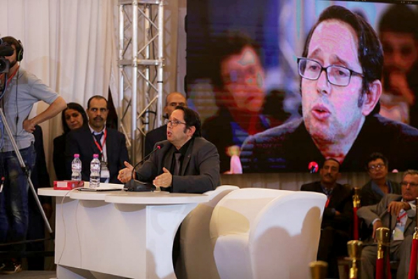 Sami Brahim testifies during Tunisia's first public hearing.