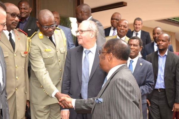 Col. Muntazini shaking hands with the Minister of Justice