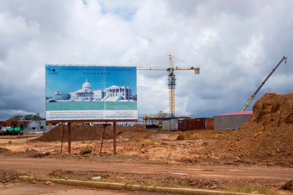 After spending several million dollars on government buildings in Malabo, the capital,and Bata, the nation's economic center, Equatorial Guinea is pouring billions of dollars into building a new administrative capital, Oyala, in the middle of the jungle. The IMF estimates that spending on Oyala would consume half the 2016 national budget. Above is the construction site with a billboard advertising the planned senate building in Oyala.