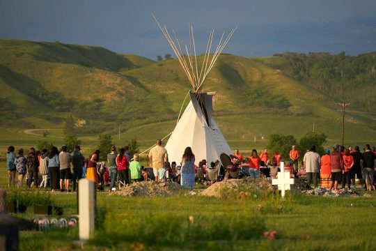 Indigenous ceremony near the graves of children who were victims of Canadian residential schools during the colonial era