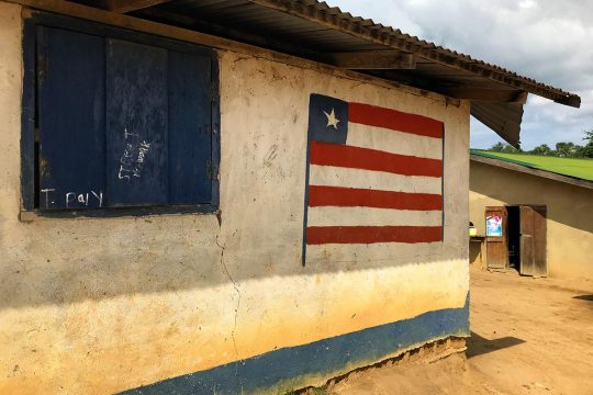 Liberian flag on the wall of a house in a village in Liberia