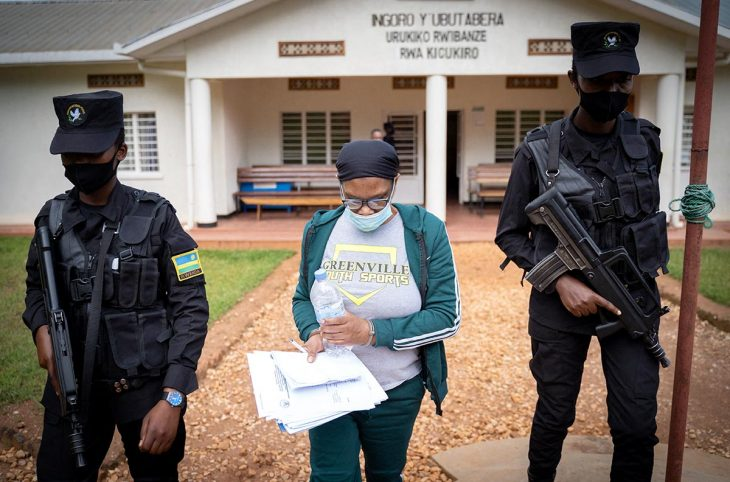 Béatrice Munyenyzezi escorted by police officers in Kigali