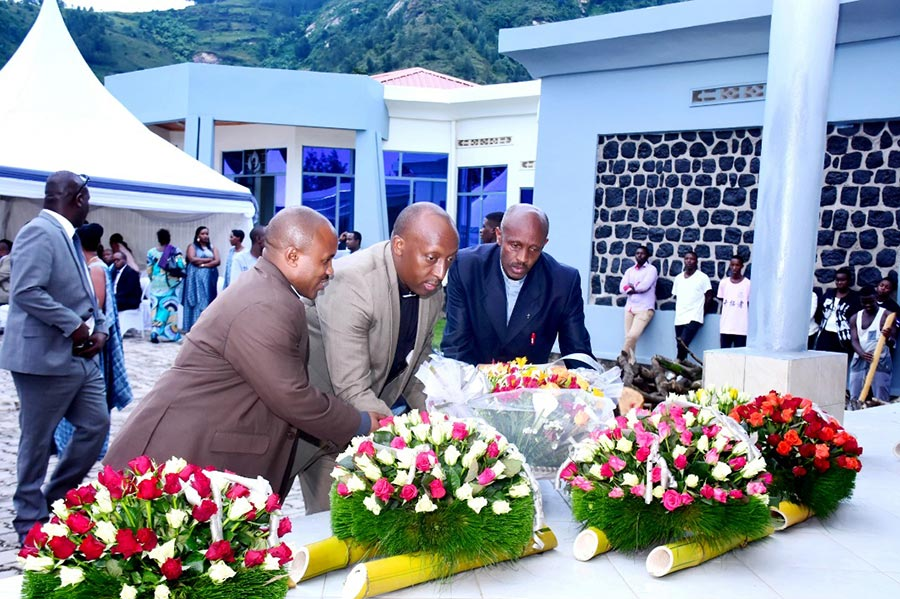 """Survivors of the genocide lay a wreath at the """"Red Commune"""" memorial in Rwanda."""